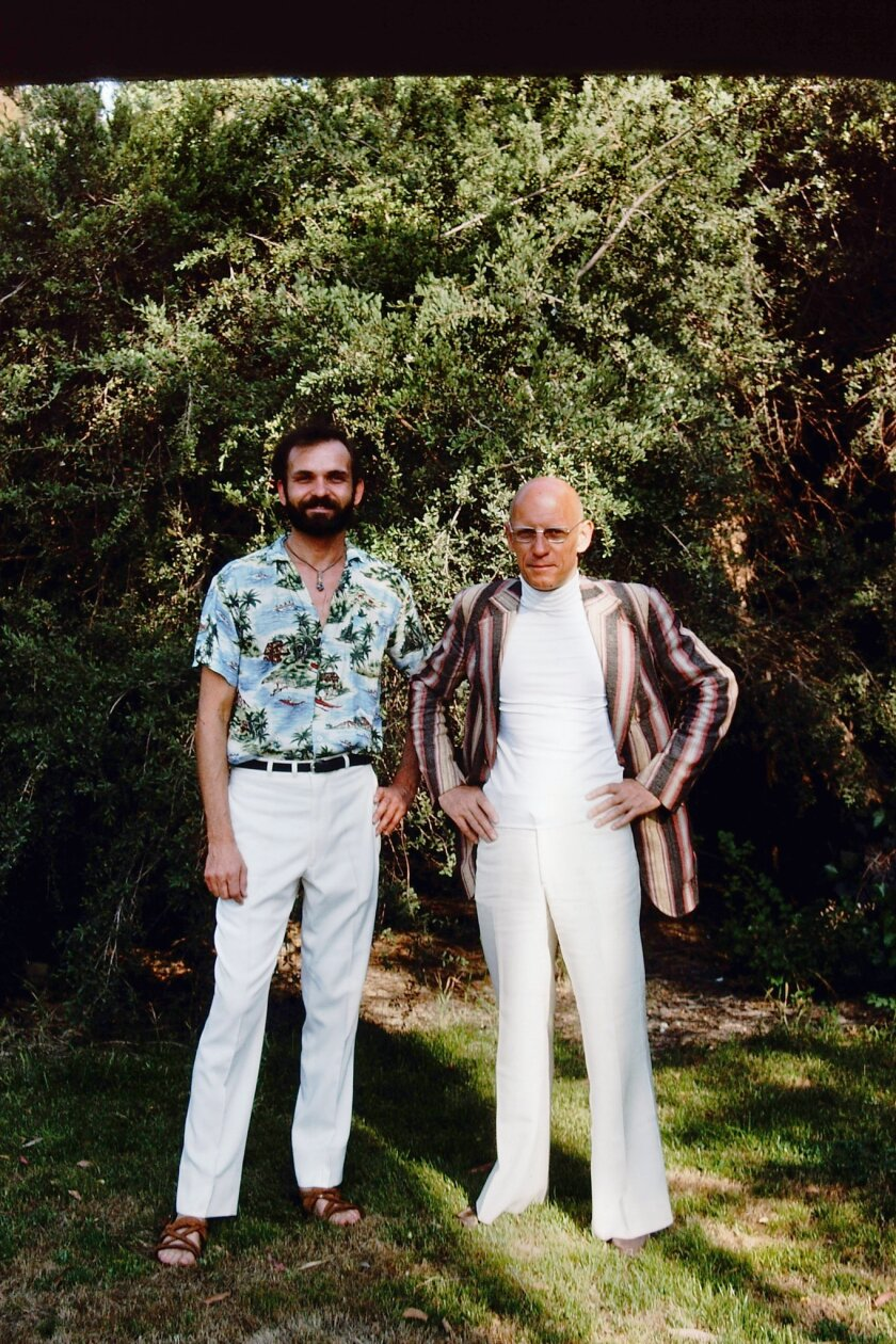 "A photograph of Simeon Wade and Michel Foucault featured in the book ""Foucault in California."" Credi"