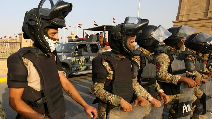 Security forces deploy around the provincial government building during a demonstration demanding be