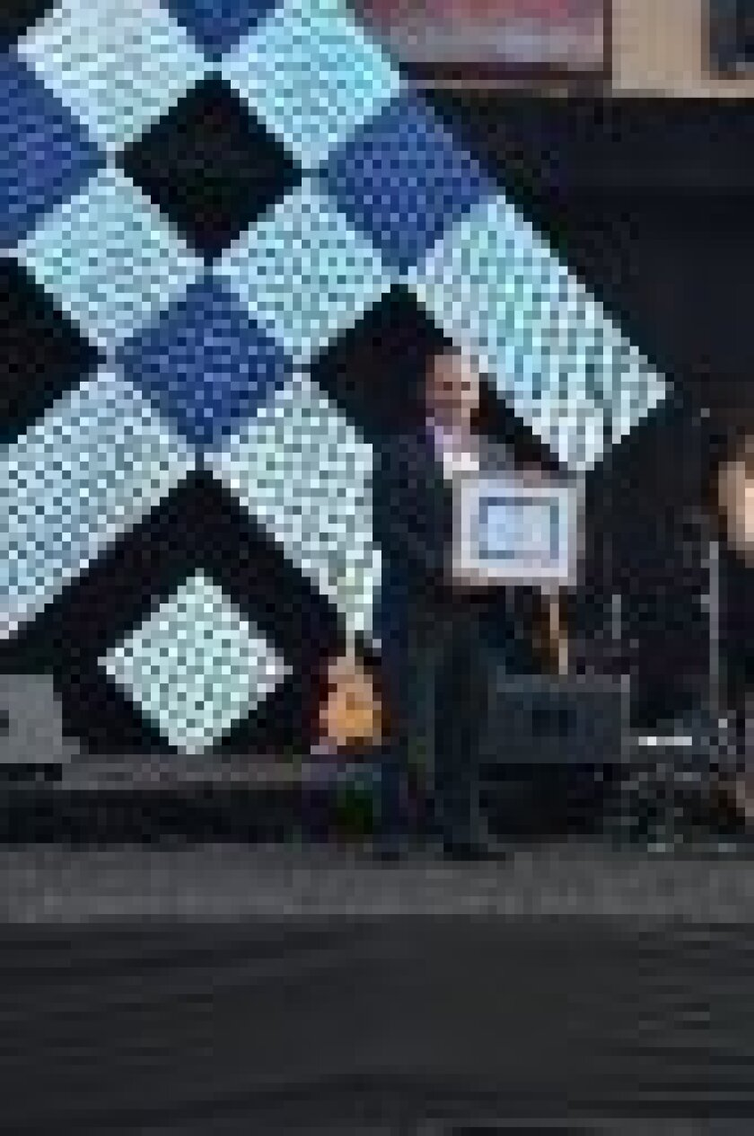 Marc Romano with his award. Courtesy photo