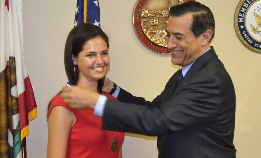 """Congressman Darrell Issa presents Margaret """"Sissy"""" Sugarman her Congressional Award for Public Service at an April 6 ceremony held at his Vista office."""