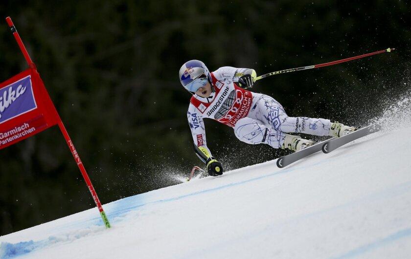 Lindsey Vonn, of the United States, speeds down the course during an Alpine Ski women's World Cup Super G race, in Garmisch Partenkirchen, Germany, Sunday, Feb. 7, 2016. (AP Photo/Marco Trovati)