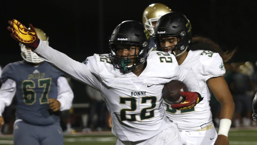 Narbonne linebacker Raymond Scott (22) recovers a fumble in the third quarter against Long Beach Poly High School on Sept. 2, 2016.