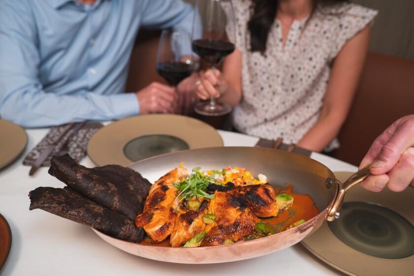 A dish served tableside at Ponto Lago restaurant at the Park Hyatt Aviara in Carlsbad.