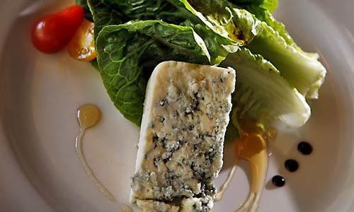 Fresh clipped lettuce, candied walnuts, with wedge of Danish blue cheese from chef David Slay at ParkAve restaurant.