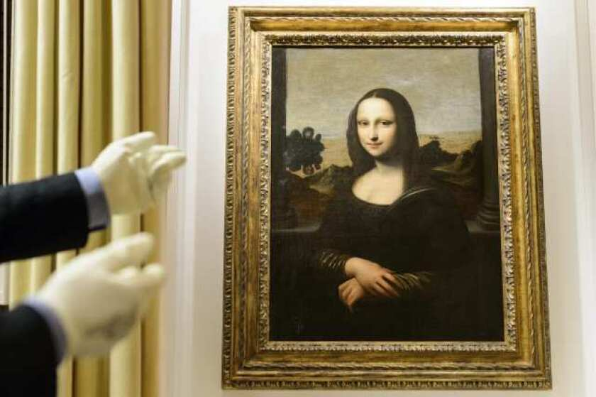 "A painting attributed to Leonardo da Vinci that a Swiss group claims is an early version of the famous ""Mona Lisa."""