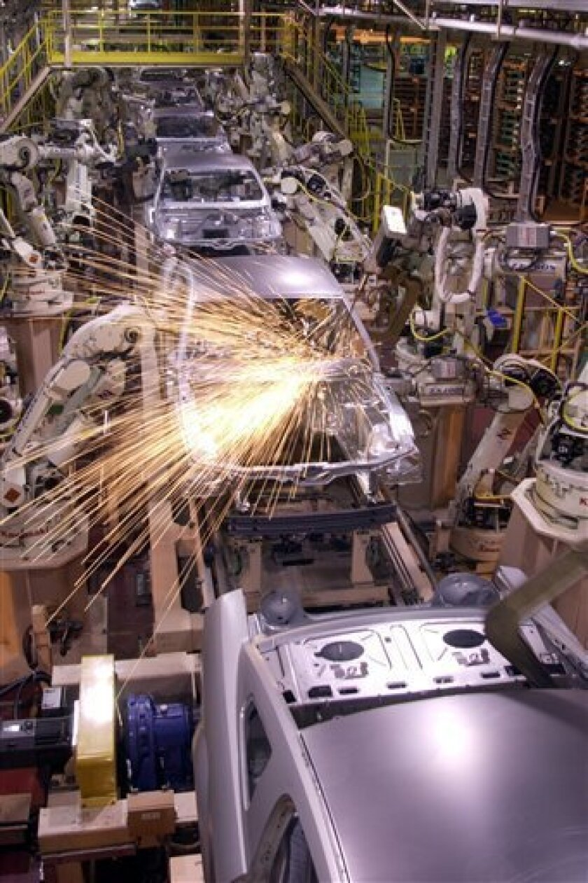 FILE - In this Sept. 27, 2004 file photo, assembly-line robots weld the new 2005 Ford Mustang at the AutoAlliance International plant in Flat Rock, Mich. Mazda Motor Co., which runs the plant jointly with Ford in Flat Rock, said Monday, June 6, 2011, it will stop building the midsize Mazda 6 at its only U.S. factory. (AP Photo/Carlos Osorio, file)