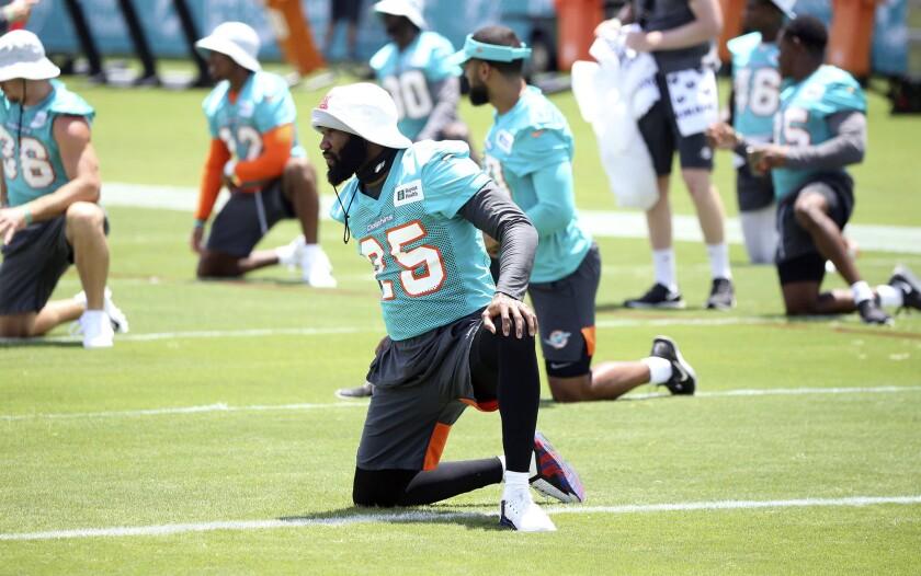 Miami Dolphins cornerback Xavien Howard warms up at the NFL football team's new training facility at Hard Rock Stadium in Miami Gardens, Fla., Friday, Aug. 6, 2021. (Charles Trainor Jr./Miami Herald via AP)