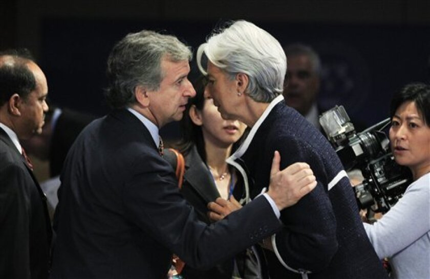 French Finance Minister Christine Lagarde, right and Chilean Finance Minister Felipe Larrain, left, talk during the International Monetary and Financial Committee (IMFC) meeting at the IMF World Bank 2010 Annual Meetings in Washington, Saturday, Oct. 9, 2010. Standing at left is Bank of Algeria Governor Mohammed Laksaci. (AP Photo/Manuel Balce Ceneta)