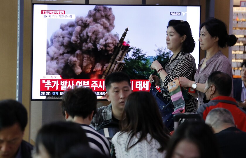 "FILE - In this Oct. 2, 2019, file photo, people watch a TV showing a file image of an unspecified North Korea's missile launch during a news program at the Seoul Railway Station in Seoul, South Korea. On Thursday, Dec. 12, 2019, North Korea accused the United States of ""hostile provocation"" on Thursday for criticizing its ballistic missile tests during a United Nations Security Council meeting and warned that the Trump administration may have blown its chance to salvage nuclear negotiations. (AP Photo/Ahn Young-joon, File)"