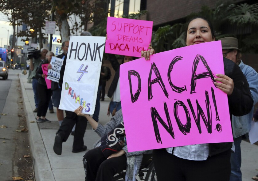Demonstrators urge protections for Deferred Action for Childhood Arrivals program (DACA) recipients outside the office of California Democratic Sen. Dianne Feinstein last week.