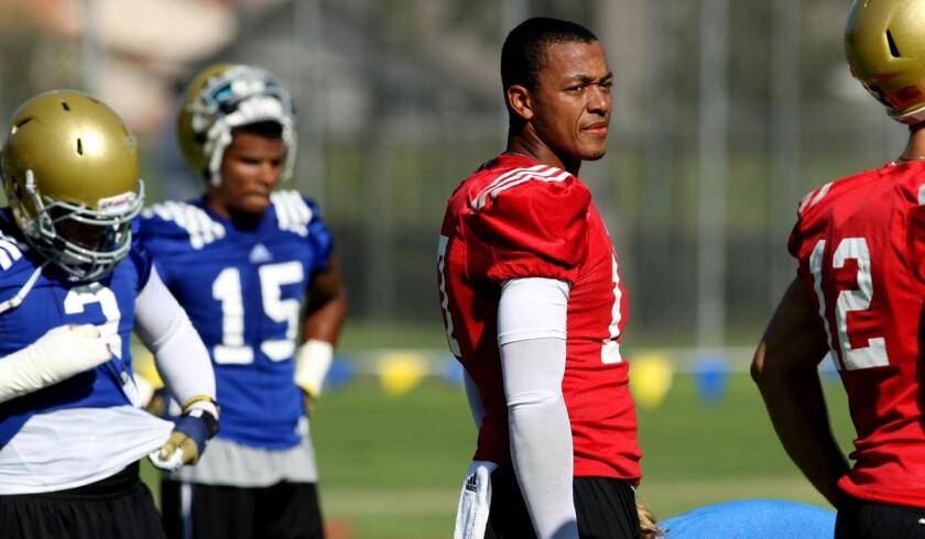 Quarterback Brett Hundley (no helmet) and his UCLA teammates will return to Cal State San Bernardino again this summer for training camp.