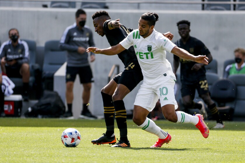 LAFC midfielder Mark-Anthony Kaye, left, and Austin FC midfielder Cecilio Dominguez battle for the ball.