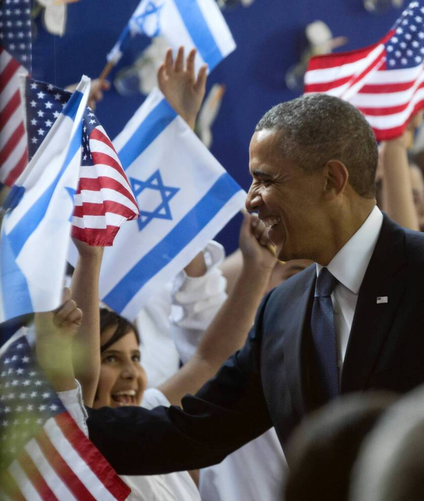 President Obama receives a welcome at the residence of Israeli President Shimon Peres in Jerusalem.