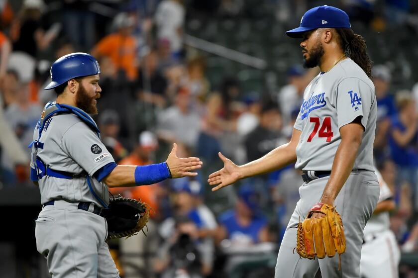 Dodgers closer Kenley Jansen celebrates with catcher Russell Martin.