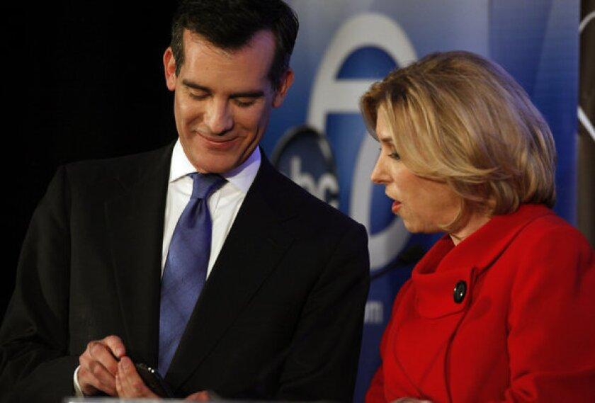 Candidates for Los Angeles mayor Eric Garcetti and Wendy Greuel talk on stage before a debate at Cal State L.A.'s Pat Brown Institute of Public Affairs.