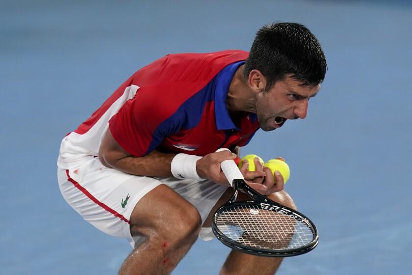 Novak Djokovic, of Serbia, reacts