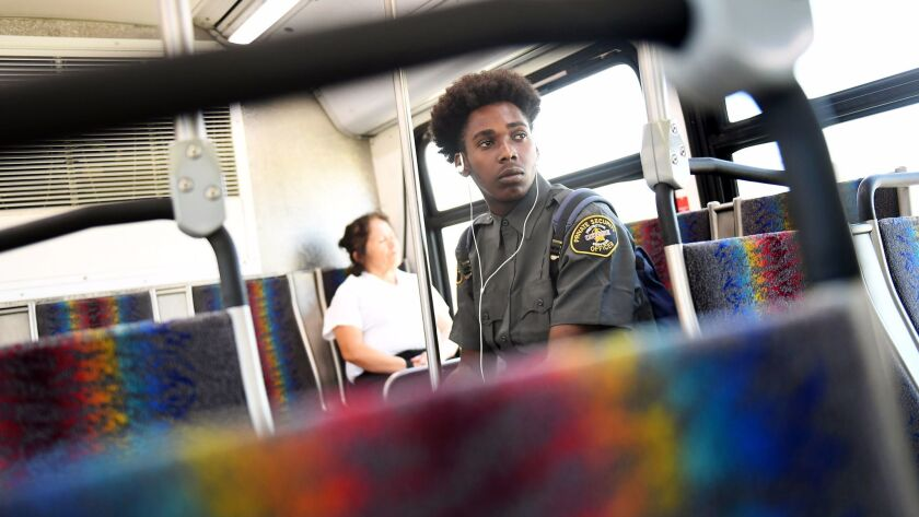Bus riders in Los Angeles on July 13.