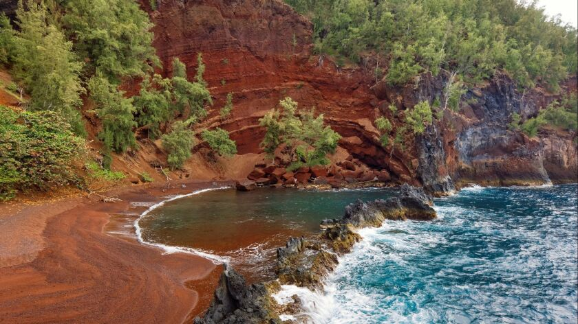 Hawaii, Maui, Hana Coastline, Kaihalulu Red Sand Beach.