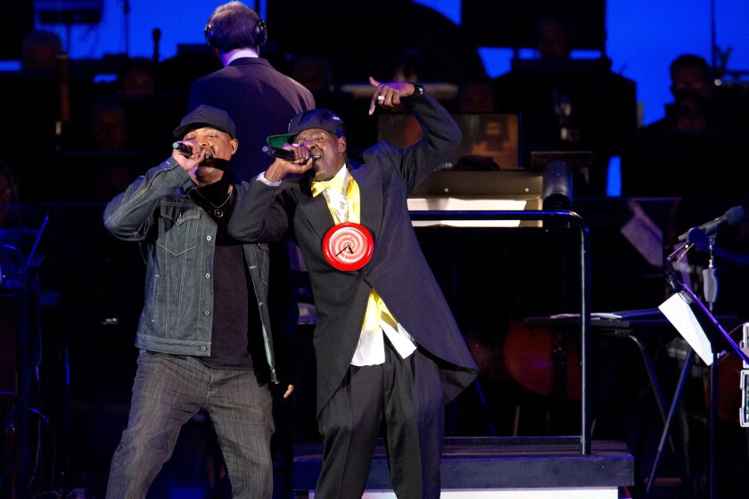 Chuck D, left, with Flavor Flav onstage with Public Enemy at the Hollywood Bowl Wednesday night.