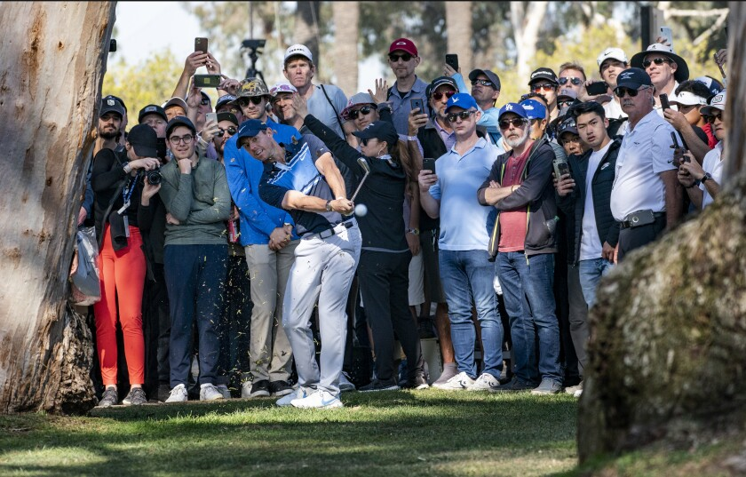 Rory McIlroy attempts a shot between trees from the rough at No. 13 during the final round of the Genesis Invitational at Riviera Country Club on Feb. 16, 2020.