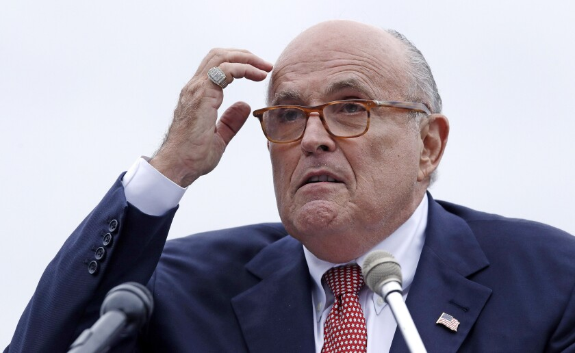 Opinion: Human 'hand grenade' Giuliani wants Biden's work in Ukraine investigated. What about his own?