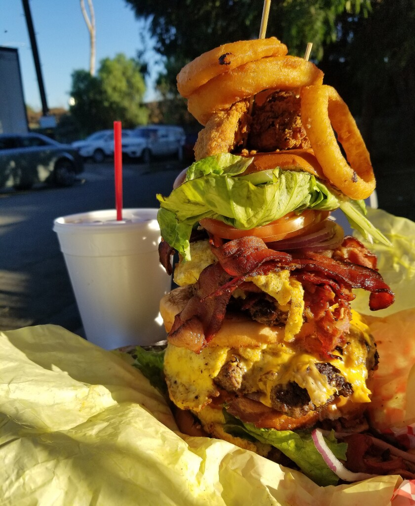 The Leaning Tower of Watts burger at Hawkins House of Burgers