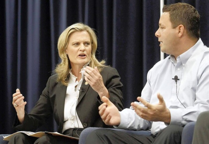 Candidates for the 74th Assembly District, from left, Leslie Daigle and Allan Mansoor talk over one another as they address questions during a Feet to the Fire forum in Costa Mesa Thursday, April 5.