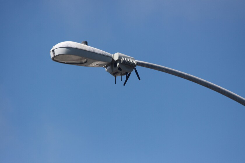 A CityIQ sensor node is attached to a streetlight in La Jolla.