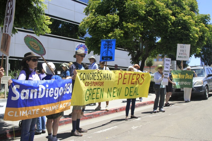 Activists protested outside U.S. Rep. Scott Peters office in San Diego's University City neighborhood to persuade him to sign onto the Green New Deal on Friday, July 19, 2019. Environmental groups have been holding such events around the region since February.