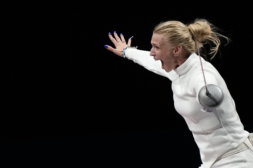Katrina Lehis of Estonia celebrates after winning the Women's Epee team final at the 2020 Summer Olympics, Tuesday, July 27, 2021, in Chiba, Japan. (AP Photo/Andrew Medichini)