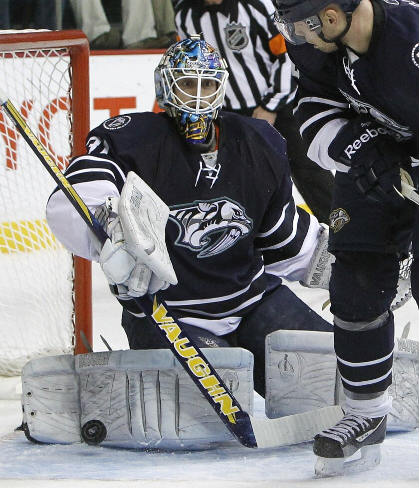 FILE - In this Dec. 18, 2010, file photo, Nashville Predators goalie Mark Dekanich (31) can't stop a shot by Los Angeles Kings left wing Ryan Smyth, not shown, in the second period of an NHL hockey game in Nashville, Tenn. Dekanich is one of 15 players demanding unpaid wages dating back months at Croatian club Medvescak Zagreb, one of 28 teams from seven countries in the Kontinental Hockey League. He is typical of many North Americans in the KHL, a veteran of college hockey and NHL farm teams now looking for success abroad. His time in the NHL itself was limited to 50 minutes for the Nashville Predators in 2010. (AP Photo/Mark Humphrey, File)