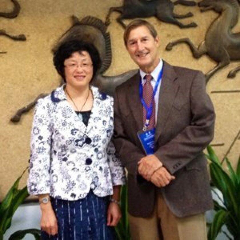 Dr. Stuart Grauer with Communist Party School representative and Vice Principal  Shangai Gezhi School at Shanghai's oldest high school.