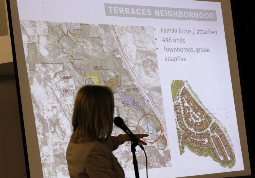 Rita Bradin, with Newland Communities, shows the plans for the Newland Sierra housing development project on a projection screen during a meeting of the Twin Oak Community Sponsor Group at Twin Oaks Elementary School in San Marcos on Wednesday.