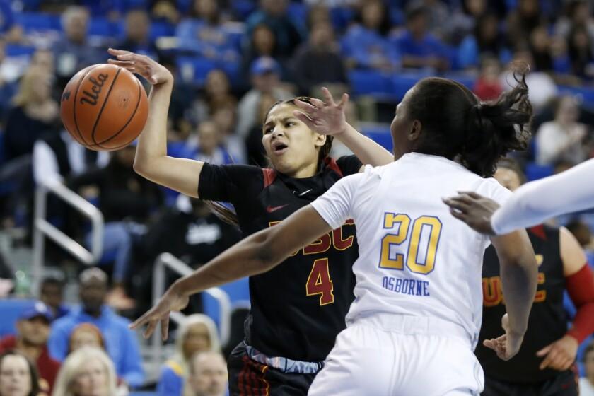 USC freshman guard Endyia Rogers battles UCLA's Charisma Osborne on Dec. 29, 2019.