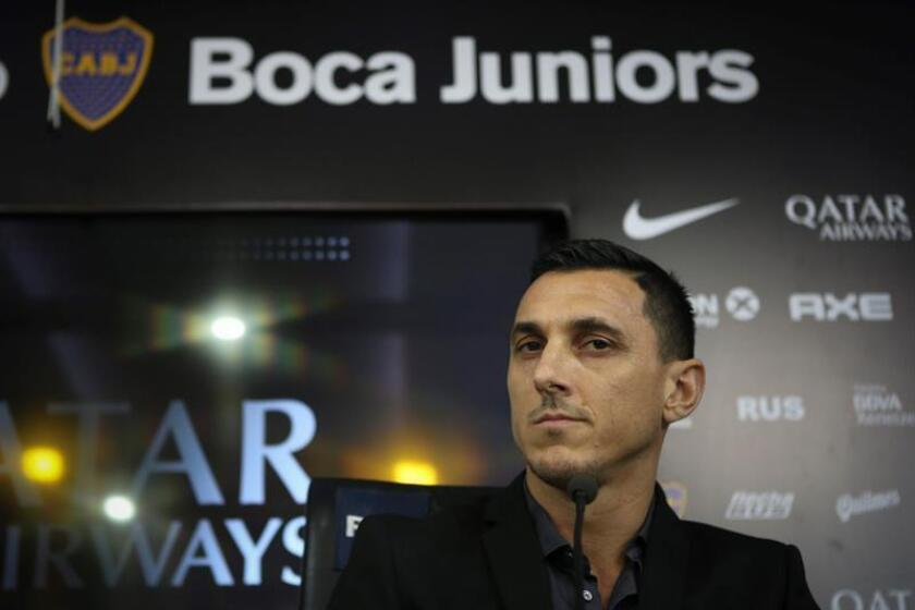 One-time Boca Juniors star Nicolas Burdisso speaks at a press conference in Buenos Aires on Monday, Dec. 17, after being named the club's new sporting director. EFE-EPA/Juan Ignacio Roncoroni