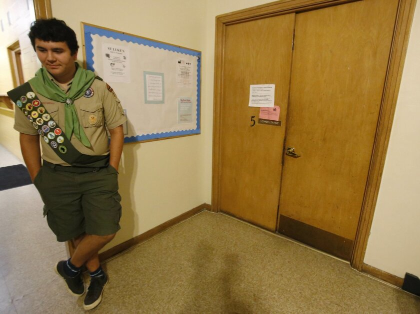 In this Monday, Sept. 14, 2015 photo, Boy Scout David Fite waits for his chance to present the results of his Eagle project in Chicago. Eagle is the highest rank in the Boy Scouts and is earned when a scout has 21 merit badges and completes a community service project, which he plans and executes.