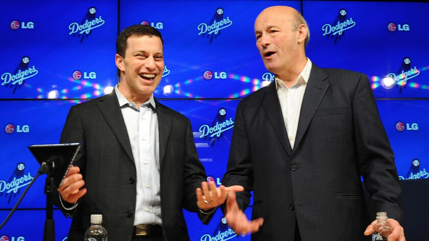 Andrew Friedman, the Dodgers' president of baseball operations, left, speaks with team President and CEO Stan Kasten during a news conference at Dodger Stadium on Oct. 17.