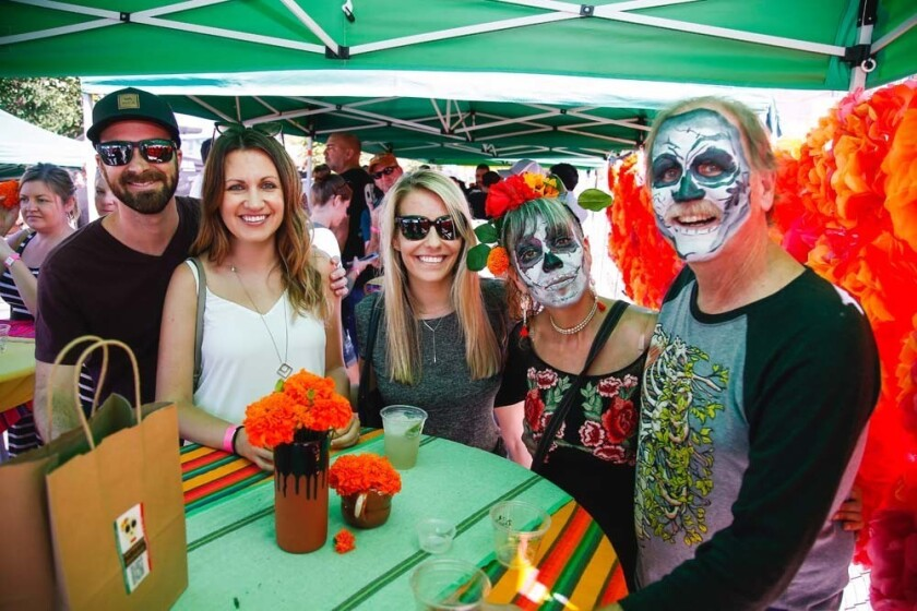 Attendees enjoying Artelexia's Day of the Dead Festival in North Park.