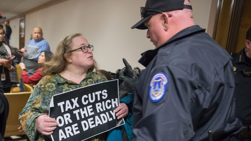 Protesters demonstrate near the full Senate Budget Committee markup of the tax reform legislation on Capitol Hill on Nov. 28.