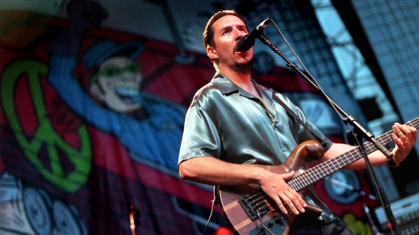 Les Claypool of Primus performs at the 1997 H.O.R.D.E festival at Irvine Meadows.