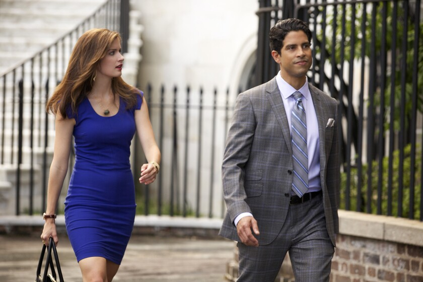 "Anna Wood, left, and Adam Rodriguez in ""Reckless."""