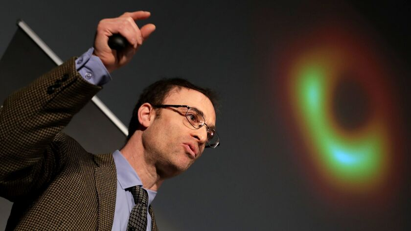 Shep Doeleman, project director of the Event Horizon Telescope, unveils the historic black hole picture in Washington, D.C.