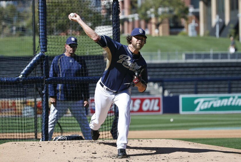 Padres pitcher Josh Johnson, who is working his way back from elbow surgery, throws at full speed against live hitters as Padres' pitching coach Darren Balsley watches prior to a baseball game against the Houston Astros Tuesday, April 28, 2015 in San Diego.