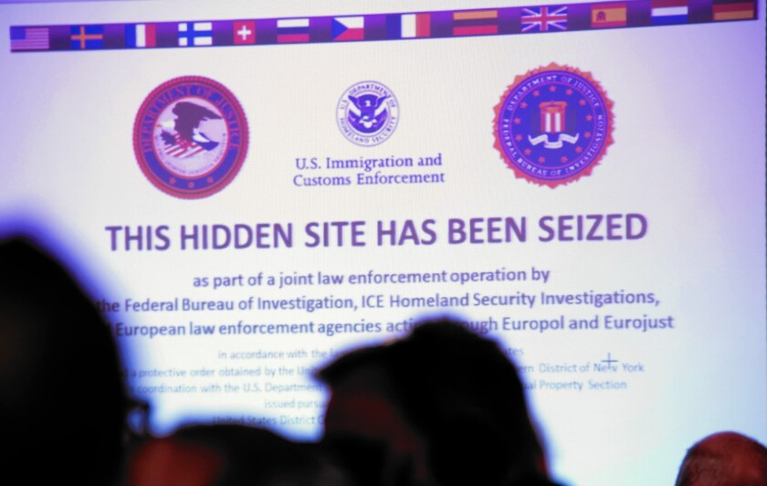 "The words ""This hidden site has been seized"" are shown on a screen for Silk Road 2.0, an online black market for drugs, during a news conference at the Hesse Office of Criminal Investigations in Wiesbaden, Germany. Silk Road 2.0 was closed down by the FBI this month."